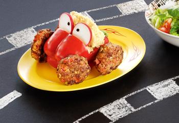 Fleischlaibchen mit Couscous im Paprika